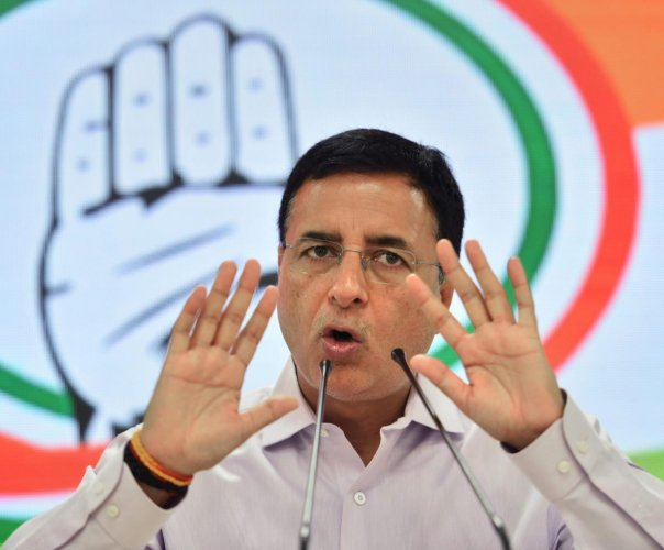 """""""BJP's 'donation saga' gets murkier -- Electoral Bond Scam to donations from accused of 'terror funding'! Why did BJP receive Crores in donation from a Company accused of buying properties of Iqbal Mirchi, a Dawood Ibrahim aide? Is this not 'treason' Mr Amit Shah?"""" Surjewala said. Photo/PTI"""