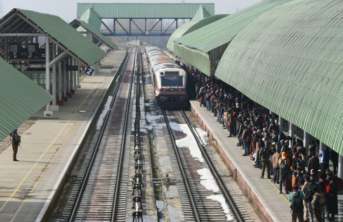 Passengers wait as Baramulla-Srinagar-Banihal bound train arrives at a station in Srinagar, Sunday, Nov. 17, 2019. The rail service in Kashmir valley was fully resumed after it was suspended on 3rd August ahead of centre decision of abrogation of article