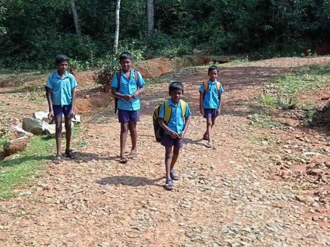 Schoolchildren walk to school in Sringeri.