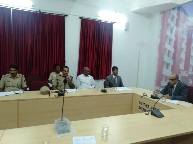 Kadluru Sathyanarayana Acharya, DLSA chairman and district and sessions judge, interacts with stakeholders on preventing youth from becoming victims of drug abuse.