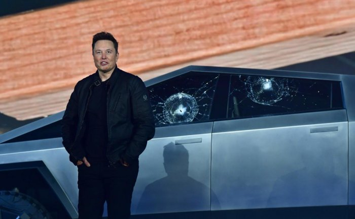 Tesla co-founder and CEO Elon Musk stands in front of the shattered windows of the newly unveiled all-electric battery-powered Tesla's Cybertruck at Tesla Design Center in Hawthorne, California. Photo/ AFP