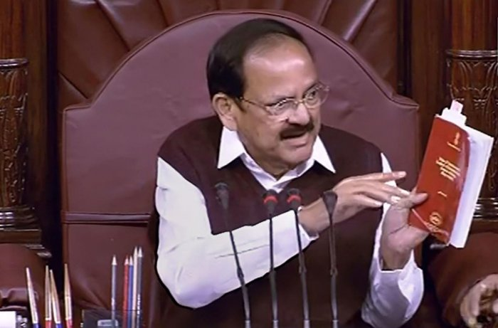 Rajya Sabha Chairman M Venkaiah Naidu conducts proceedings in the House during Winter Session of Parliament, in New Delhi, Friday, Nov. 22, 2019. (RSTV/PTI Photo)