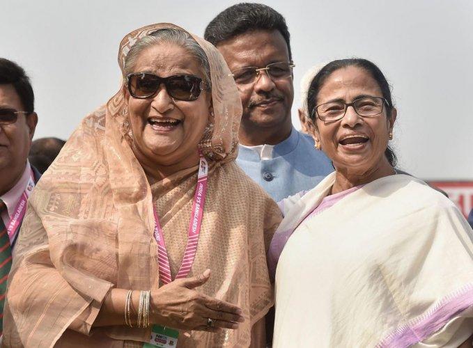 Kolkata: Bangladesh's Prime Minister Sheikh Hasina and West Bengal Chief Minister Mamata Banerjee during the historic pink-ball day/night cricket test match between Indian and Banglades, at the Eden Gardens in Kolkata, Friday, Nov. 22, 2019. (PTI Photo)