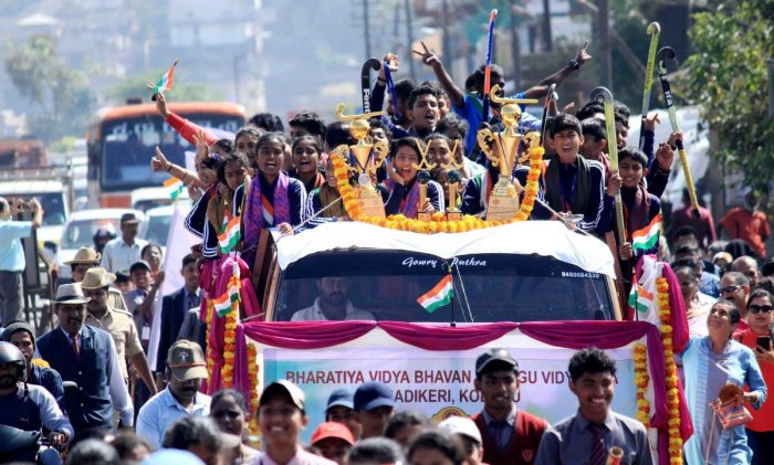 The winning teams go on a victory parade in an open vehicle in Madikeri on Friday.