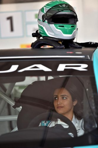 Saudi Arabia's first female race driver Reema al-Juffali is pictured inside her car during an interview with AFP in Diriyah district in Riyadh on November 20, 2019, ahead of the international Jaguar I-PACE eTROPHY series for electric zero-emission cars se