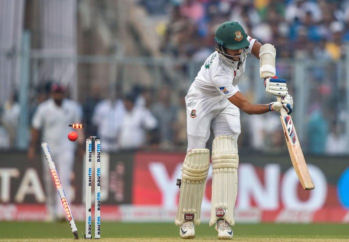 Bangladesh's Nayeem Hasan's off-stump is knocked off by Indian paceman Ishant Sharma on the opening day of the pink ball Test at the Eden Gardens on Friday. PTI