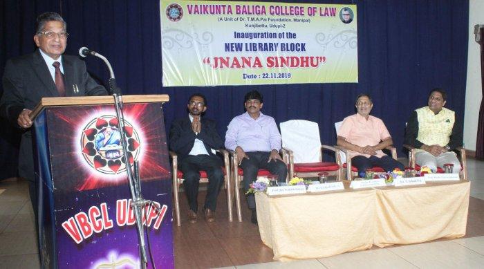 Lokayukta Justice P Vishwanath Shetty speaks after inaugurating the library at Vaikunta Baliga College of Law in Udupi.