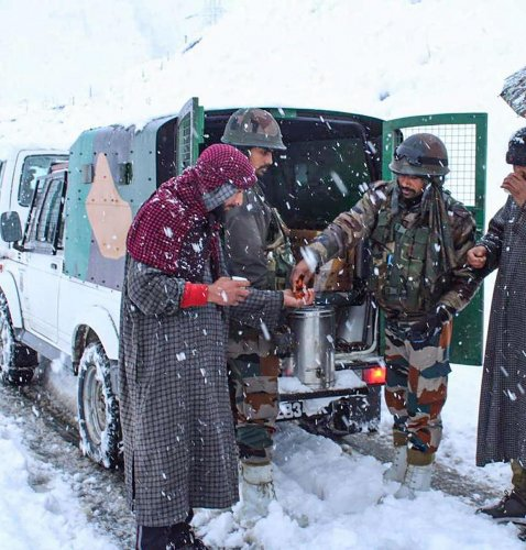 Army personnel during the rescue operation of civilians stranded due to heavy snowfall near Zojila Pass in J&K, on Friday. Approximately 300-350 people, including women and children, were stranded at heights above 11,000 feet and temperatures of minus
