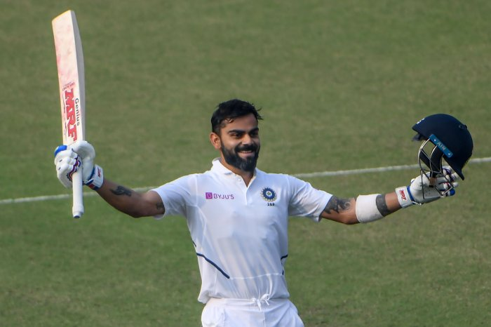 India's captain Virat Kohli celebrates his century (100 runs) during the second day of the second Test cricket match of a two-match series between India and Bangladesh at the Eden Gardens cricket stadium in Kolkata. (AFP Photo)