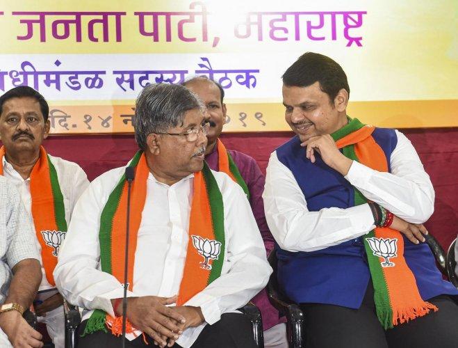 Chandrakant Patil and Devendra Fadnavis. (PTI File Photo)