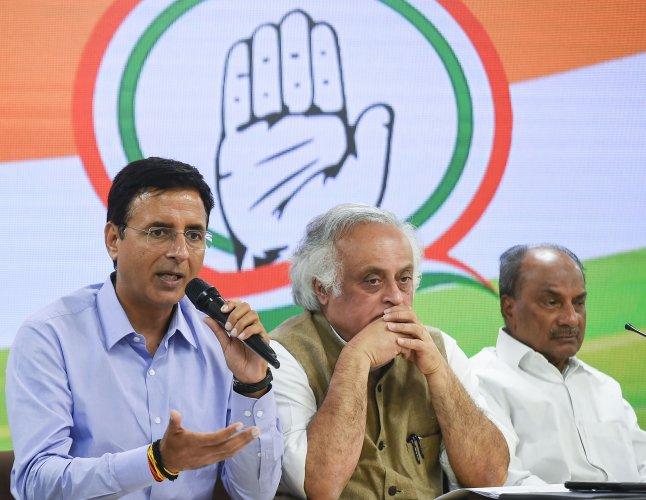 Senior Congress leaders Randeep S Surjewala, Jairam Ramesh and AK Anthony during a press conference at AICC HQ in New Delhi. (PTI Photo)
