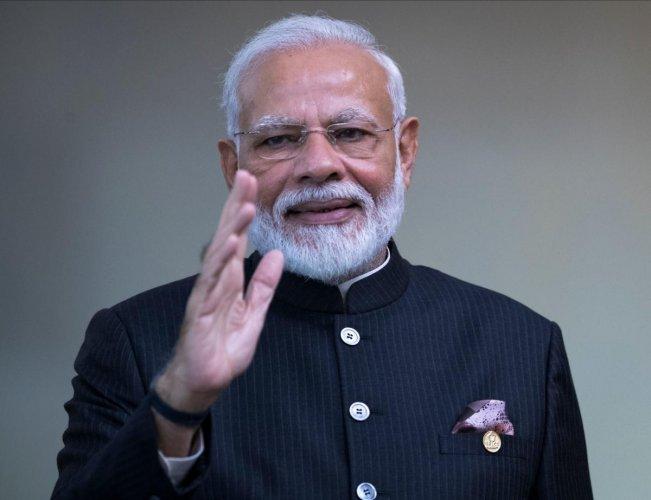 India's Prime Minister Narendra Modi waves the press. (AFP)