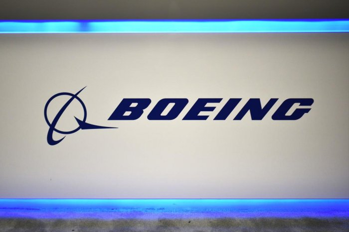 In this file photo taken on October 22, 2019 the Boeing logo is seen during the the 70th annual International Astronautical Congress.