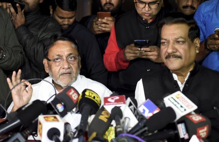 Nationalist Congress Party (NCP) leader Nawab Malik (L) along with Congress leader Prithviraj Chavan addresses a press conference (PTI Photo)