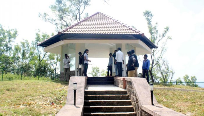 Forest department personnel inspect the place where the leopards were said to have been spotted.