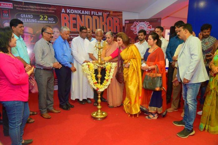 Actor Varsha Usgaonkar lights a lamp to mark the release of the Konkani movie 'Benddkar' at Big Cinemas in Mangaluru on Friday.