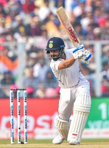 Virat Kohli drives one to the boundary en route to his 136 against Bangladesh on Saturday at the Eden Gardens. PTI
