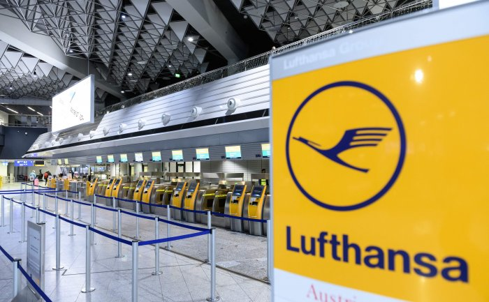 Deserted check-in desks of German airline Lufthansa are seen at the airport in Frankfurt am Main, western Germany. (AF Photo)