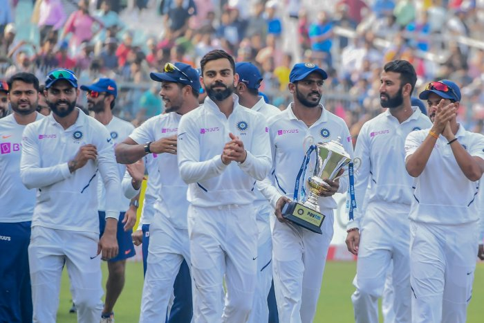 India's cricketers celebrate after winning the match during the third day of the second Test cricket match of a two-match series between India and Bangladesh at the Eden Gardens cricket stadium in Kolkata. (AFP Photo)