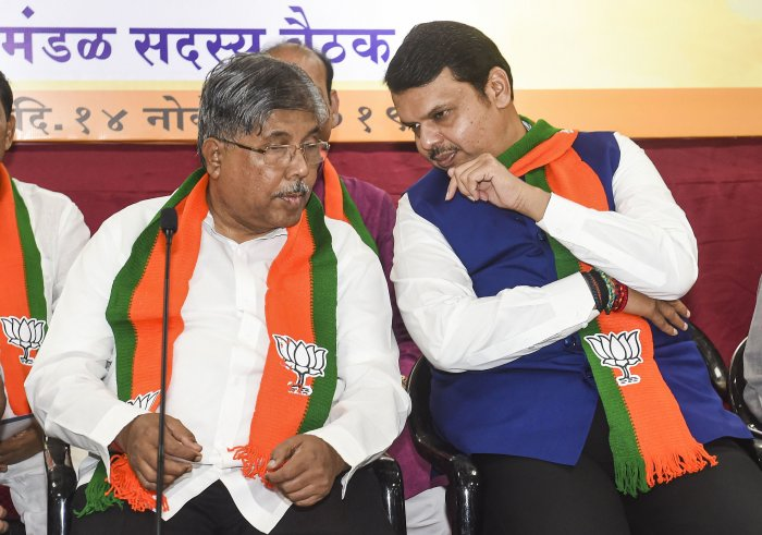 Maharashtra BJP President Chandrakant Patil with former chief minister Devendra Fadnavis during the party MLAs meeting at the BJP office in Mumbai. (PTI Photo)