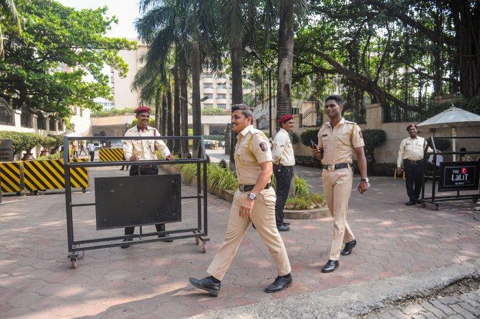 Security personnel keep vigil outside a hotel where Shiv Sena MLA's are residing, at Andheri in Mumbai. (PTI Photo)