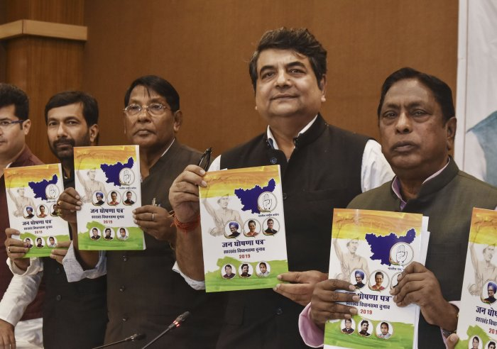Jharkhand Congress in-charge RPN Singh, state Congress President Rameshwar Oraon and others release party's manifesto for Jharkhand Assembly elections, in Ranchii. (PTI Photo)