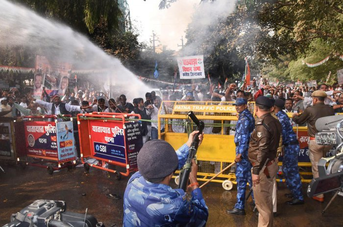 Security personnel fire tear gas to disperse Congress workers during Jan Vedna March, in Patna, Sunday, Nov. 24, 2019. (PTI Photo)