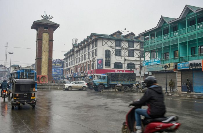 Traffic ply on roads at Lal Chowk during shutdown in Srinagar, Thursday, Nov. 21, 2019. The shutdown was intensified a day after threatening posters appeared in the many parts of the Valley. (PTI Photo)