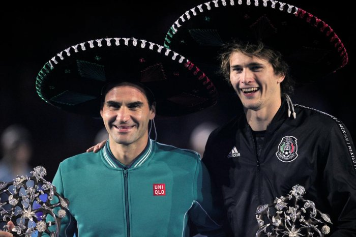 Switzerland's Roger Federer (L) and Germany's Alexander Zverev pose for pictures with Mexican hats after the exhibition tennis singles match in Mexico City, on November 23, 2019. (Photo by AFP)