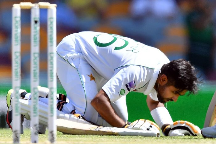 Pakistan's batsman Babar Azam celebrates reaching his century, 100 runs, on day four of the first Test cricket match between Pakistan and Australia at the Gabba in Brisbane.