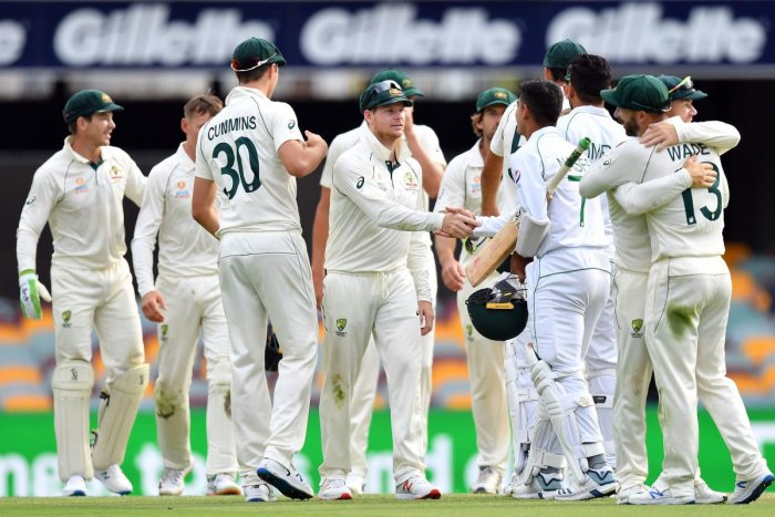 Australia's team celebrate their victory in the first Test cricket match against Pakistan at the Gabba in Brisbane. (AFP Photo)