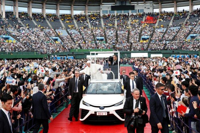 Pope Francis greets wellwishers from his Popemobile during a Holy Mass at Nagasaki Baseball Stadium, in Nagasaki, Japan, November 24, 2019. (Reuters file photo)