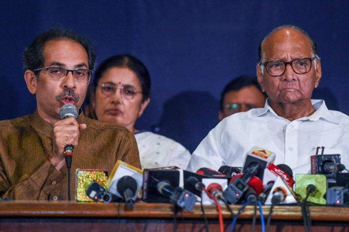 Shiv Sena party Chief Uddhav Thackeray (L) and NCP chief Sharad Pawar. (AFP Photo)