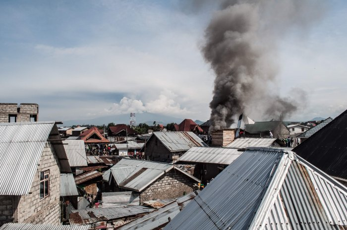 Smoke raises after a small aircraft carrying around 15 passengers crashed in a densely populated area in Goma on the East of the Democratic Republic of Congo. (AFP Photo)