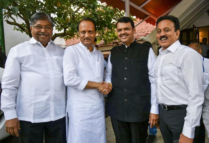 Newly-sworn in Chief Minister of Maharashtra Devendra Fadnavis with his Deputy Chief Minister Ajit Pawar. (PTI file photo)