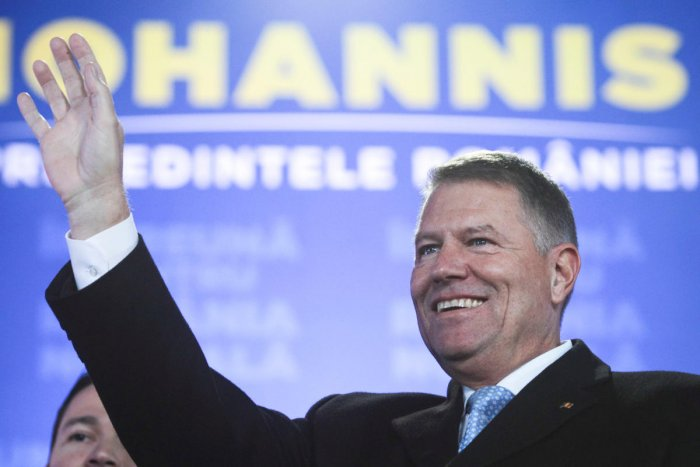 Incumbent candidate Klaus Iohannis reacts after receiving the first exit poll results following the second round of a presidential election in Bucharest. (Reuters photo)