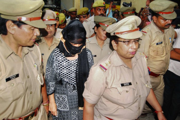The 23-year-old law student, who has accused the BJP's Swami Chinmayanand of raping her for more than a year, is brought to a local court to record her statement amid heavy security, in Shahjahanpur, Monday, Sept. 16, 2019. (PTI Photo)