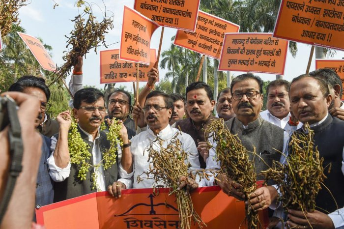 Shiv Sena leaders Sanjay Raut, Arvind Sawant, and others hold a protest near Chhatrapati Shivaji Maharaj statue, demanding the government to declare unseasonal rains in Maharashtra as natural calamity, on the first day of the Winter Session of Parliament.