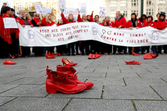 """""""The red shoes represent women killed by a man,"""" said Julie Wauters of the Mirabal group. (Photo by Reuters)"""