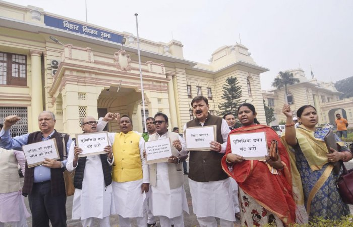 Congress legislators stage a protest during Winter Session of the Assembly, in Patna. (PTI Photo)