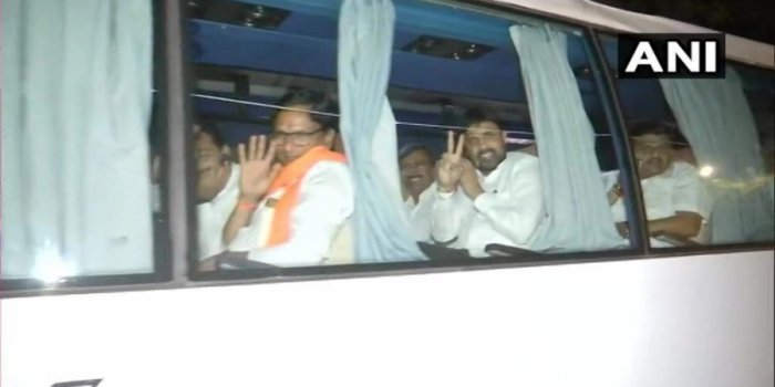TheMLAstravelled in a bus to a different hotel from Hotel Renaissance in Powai where they were put up since Saturday night, hours afterNCPleader Ajit Pawar joined hands with the BJP in a coup and took oath as deputy chief minister. Photo/ANI