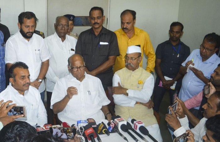 NCP President Sharad Pawar interacts with the media over the Maharashtra government formation issue, in Karad. PTI