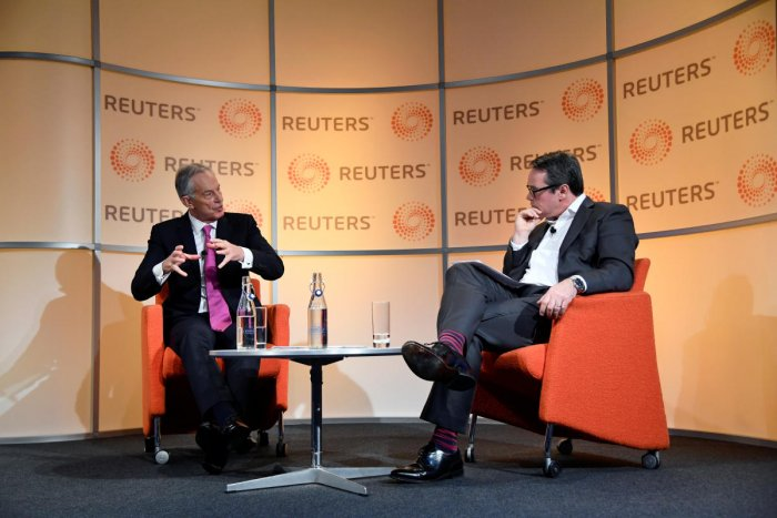"Former British Prime Minister Tony Blair speaks during an interview with Axel Threlfall at a Reuters Newsmaker event on ""The challenging state of British politics"" in London. Reuters"