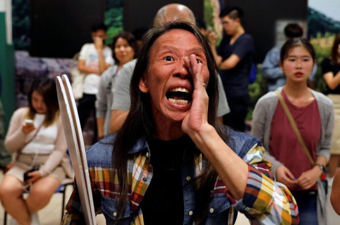 A woman reacts during the counting of the votes of the Hong Kong council elections, in a polling station in Hong Kong