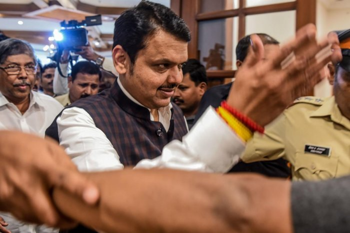 Bharatiya Janata Party (BJP) leader and Chief Minister of the western Indian state of Maharashtra Devendra Fadnavis (C) arrives for a press conference to announce his decision to tender his resignation in Mumbai on November 26, 2019. (AFP)