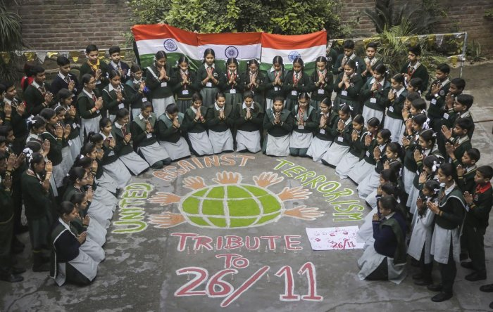 School children pay tribute to the martyrs of 26/11 Mumbai terror attacks on the eve of its 11th anniversary, in Jammu. (PTI Photo)