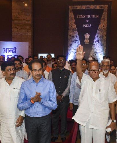 NCP chief Sharad Pawar and Shiv Sena President Uddhav Thackeray along with NCP, Congress and Shiv Sena MLAs during a gathering to display their strength of 162, at Grand Hyatt Hotel. (PTI Photo)