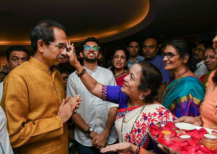 Shiv Sena President Uddhav Thackeray being greeted after he was chosen as the nominee for Maharashtra chief minister's post by Shiv Sena-NCP-Congress alliance. (PTI Photo)