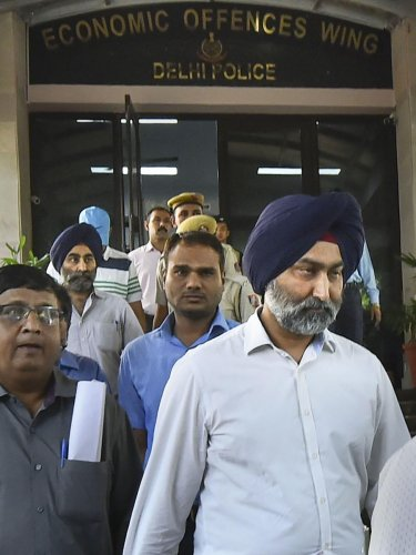 In this Oct. 11, 2019 file photo, former promoter of pharmaceutical giant Ranbaxy Malvinder Singh being arrested by the Economic Offences Wing (EOW) of Delhi Police in New Delhi. The ED on Thursday, Nov. 14, 2019 arrested Singh and former CMD of Religare