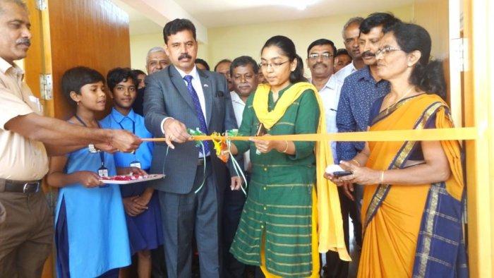 Kodagu Zilla Panchayat CEO K Lakshmi Priya inaugurates the newly built classroom by BEL in Madikeri.